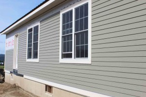 Fiber cement siding looks like real wood siding without the yearly maintenance.
