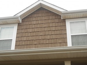 Vinyl shake siding looks just like real wood siding but costs a lot less and requires virtually no maintenance.
